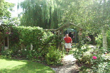 Wooden arches into another garden